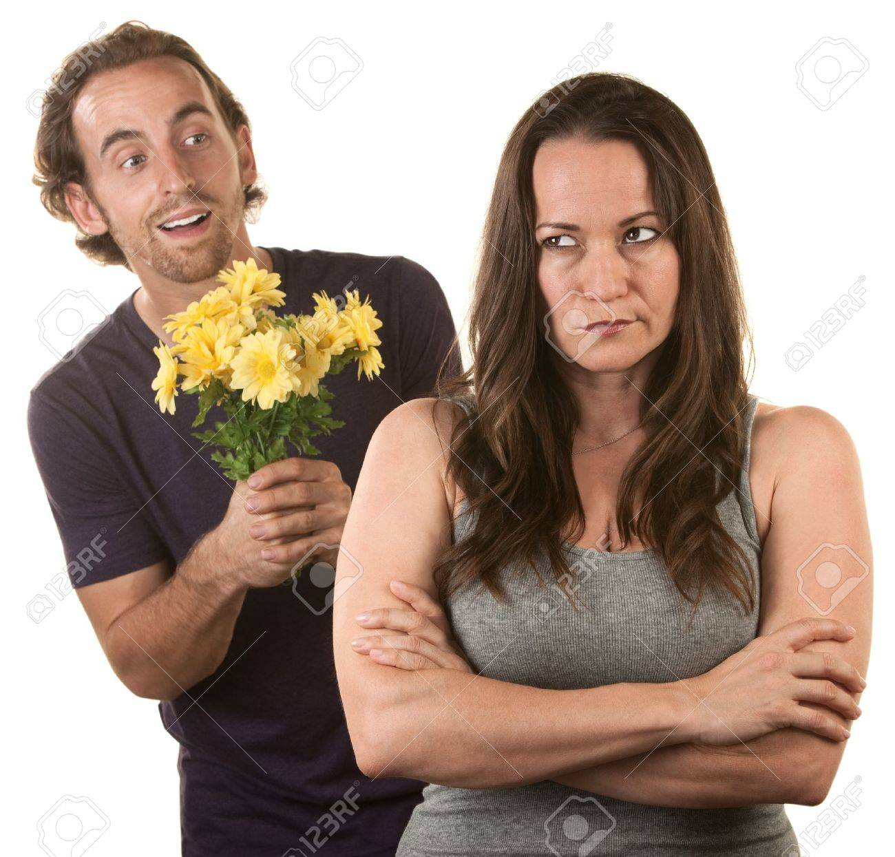 Skeptical female with smiling young man holding flowers Stock Photo - 16300088