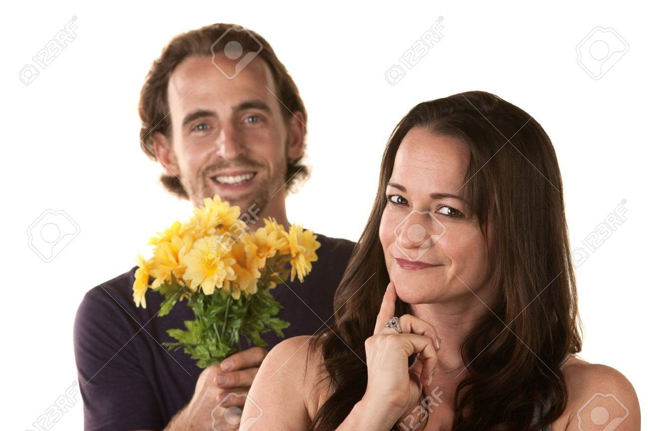 Grinning woman and smiling man holding flowers Stock Photo - 16473096