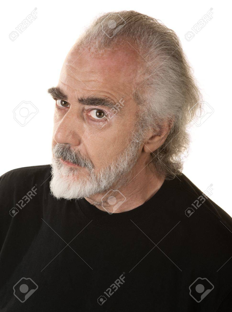 Mature bearded man in black looking suspicious Stock Photo - 16473162