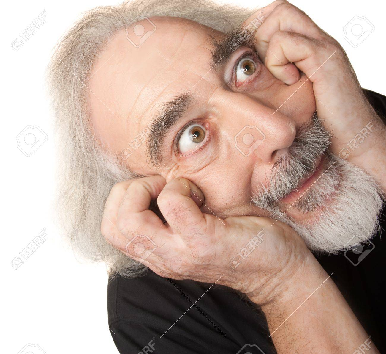 Paranoid European man in gray beard over isolated background Stock Photo - 16472956