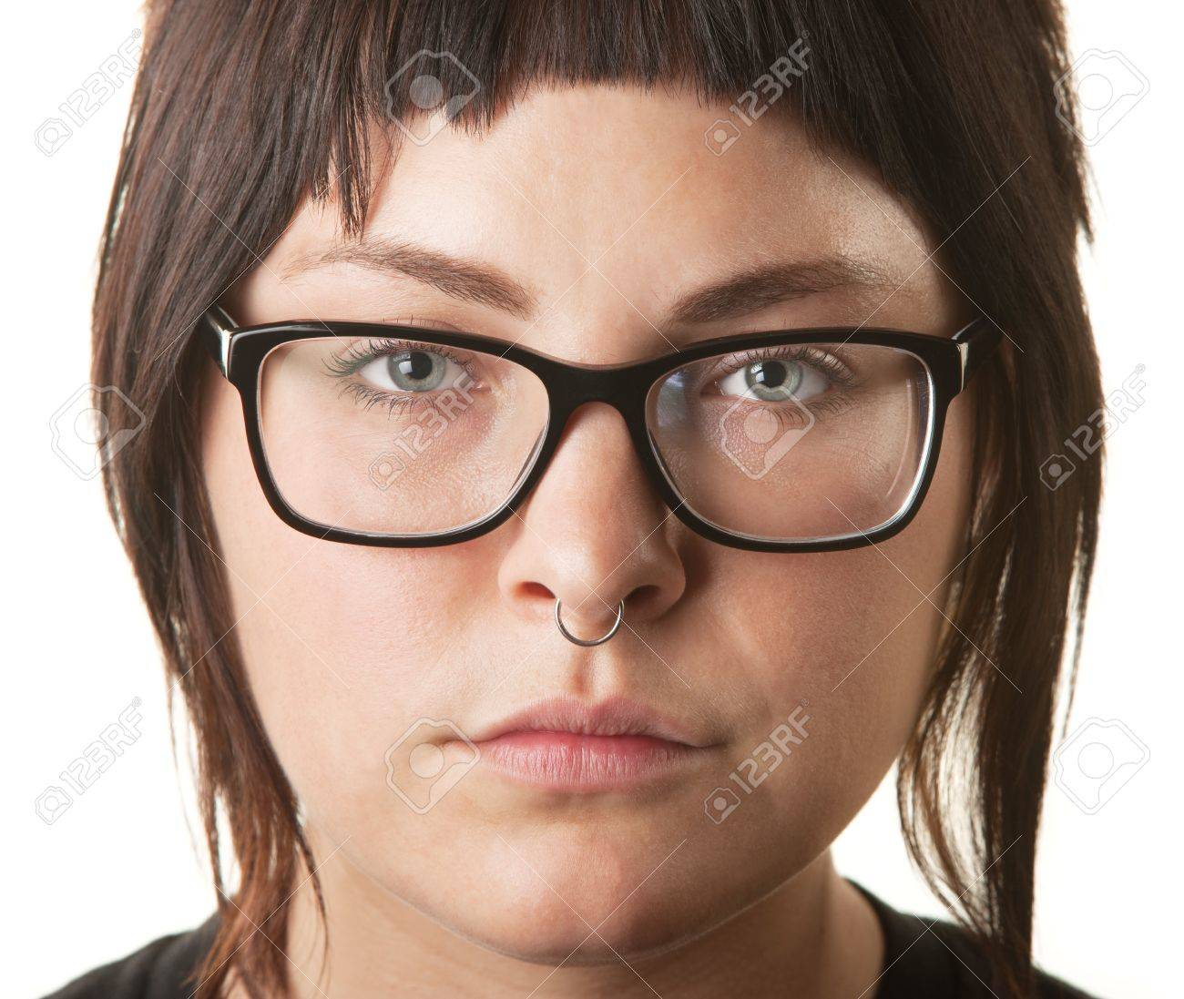 Close up of young woman with nose ring and eyeglasses Stock Photo - 16473154