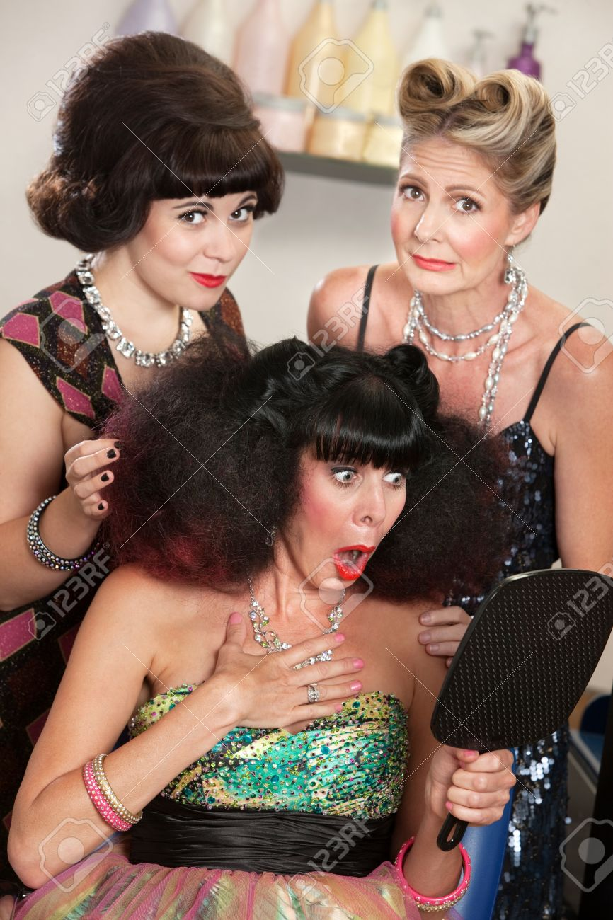 Sympathetic friends and upset woman in beauty salon Stock Photo - 16680545