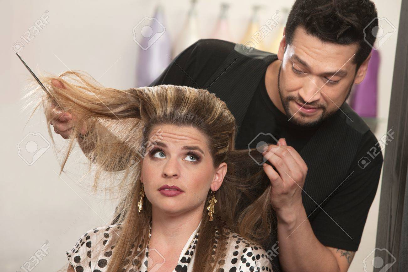 Embarrassed male hair stylist and female customer in salon Stock Photo - 16680532