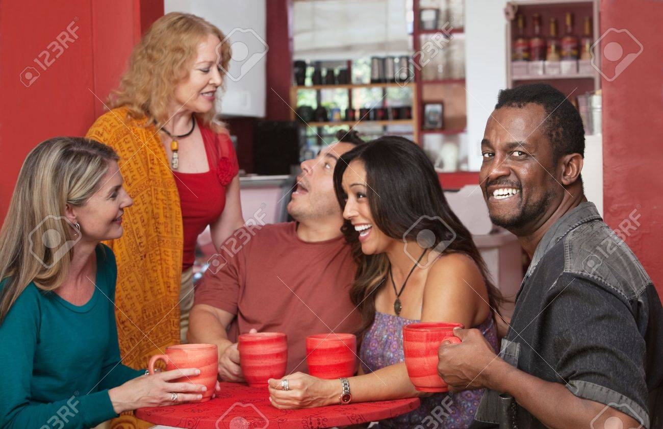 Smiling Black man drinking coffee with group of friends Stock Photo - 17019830