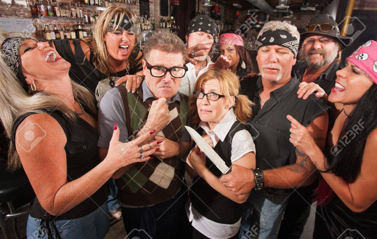Intimidated nerd couple surrounded by laughing gang with dagger Stock Photo - 17591160