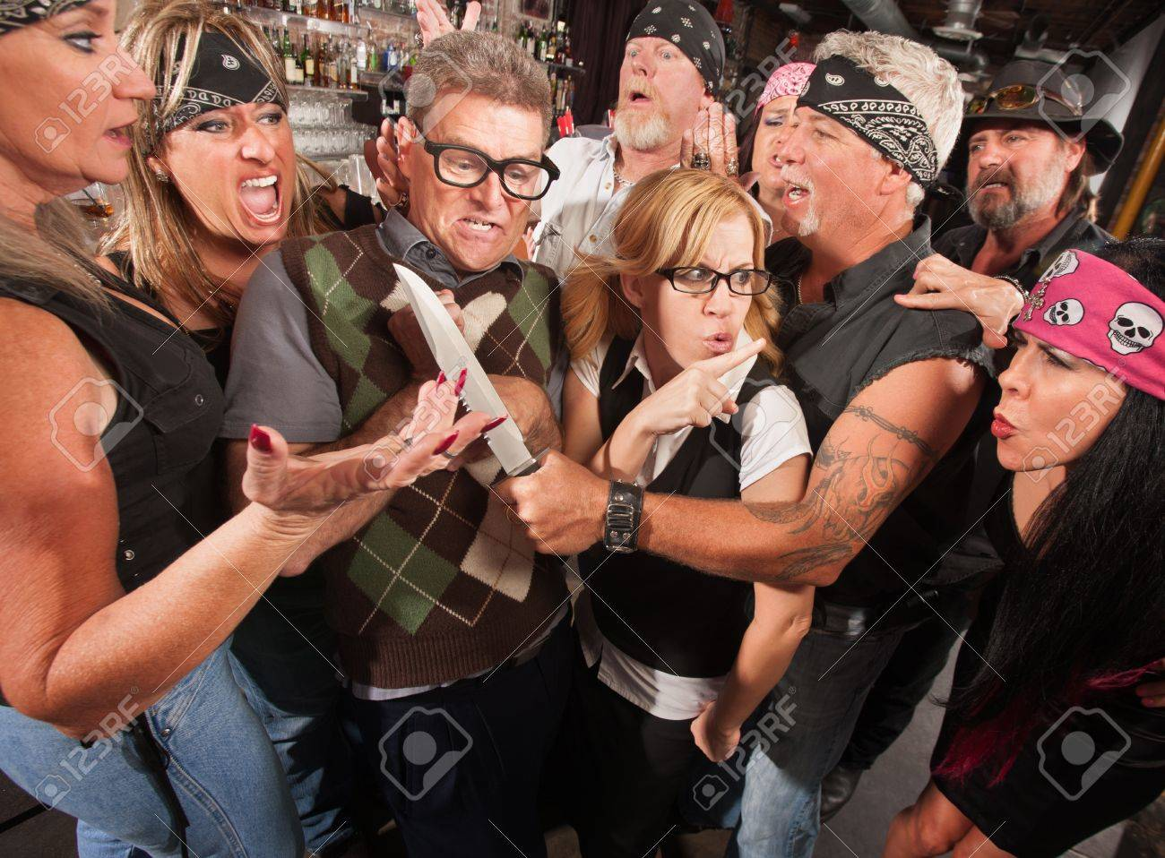 Man with biker gang threatening nerd couple Stock Photo - 17591162