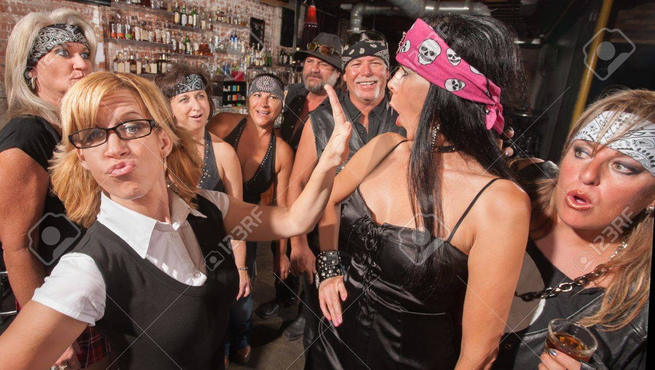 Confident nerd pushing away aggressive biker gang lady Stock Photo - 17591157