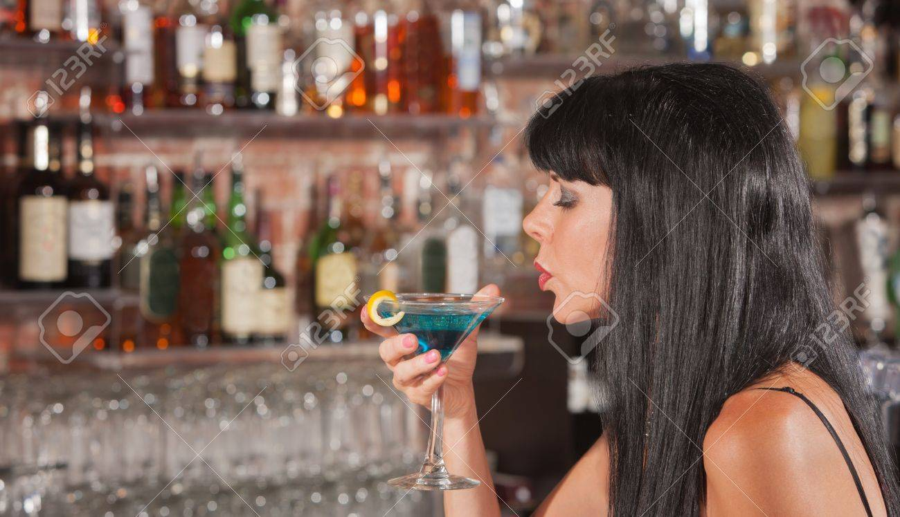 Sexy European woman enjoying her drink in a bar Stock Photo - 17591165