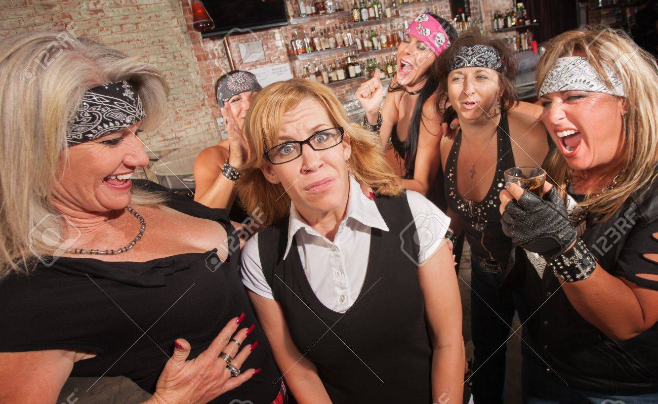 Frightened blond nerd laughed at by gang of women Stock Photo - 17703250
