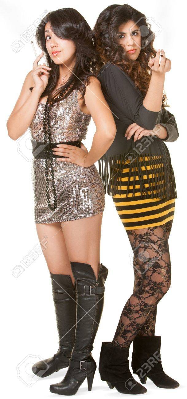 Two misbehaving teen girls in mini skirts on isolated background Stock Photo - 17991550