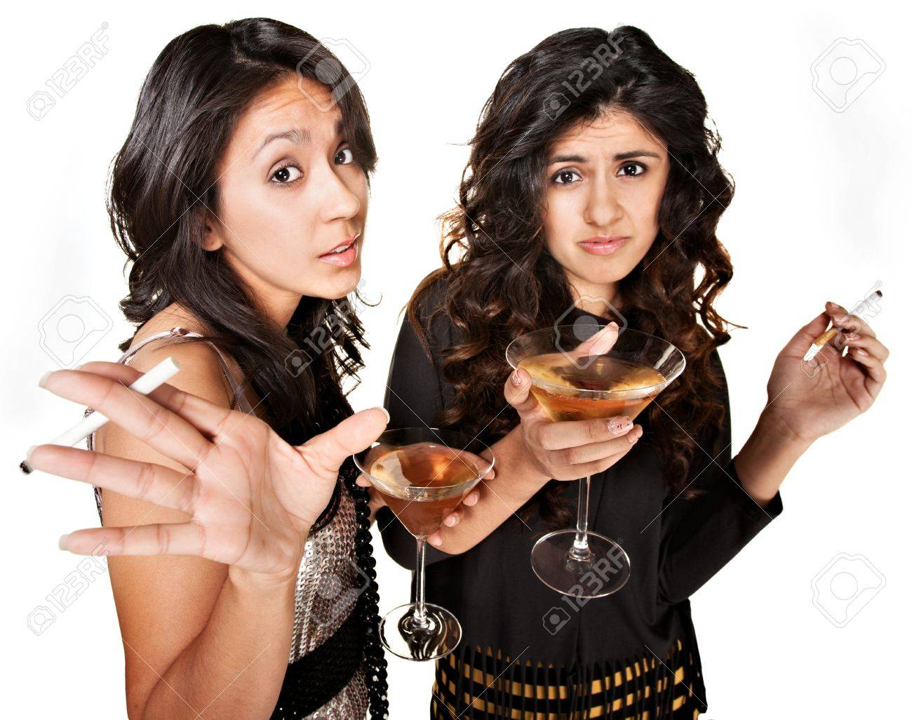 Rude club girls with cigarettes and martinis over white background Stock Photo - 17991558