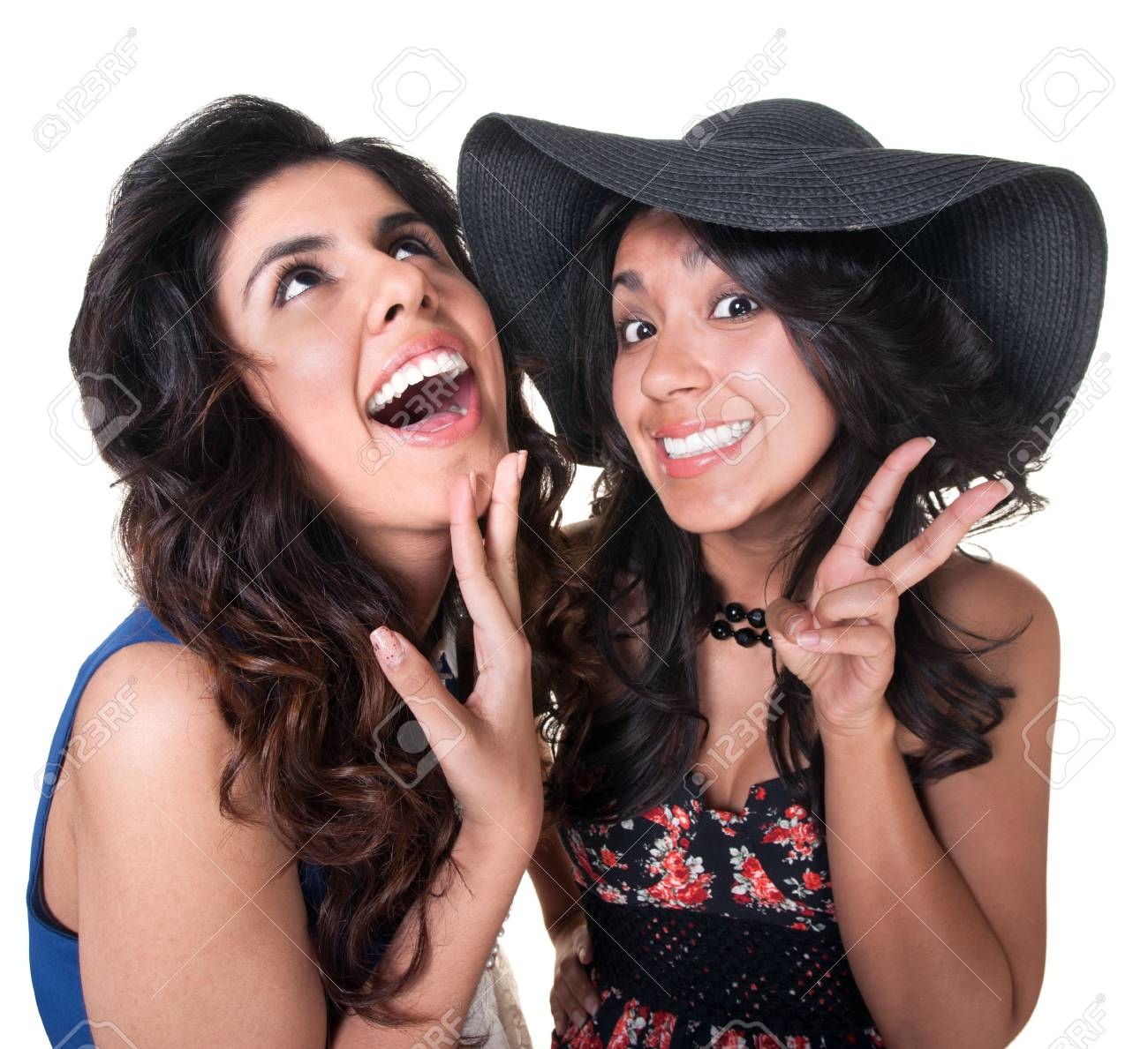 Giggling female friends on isolated background Stock Photo - 17991533