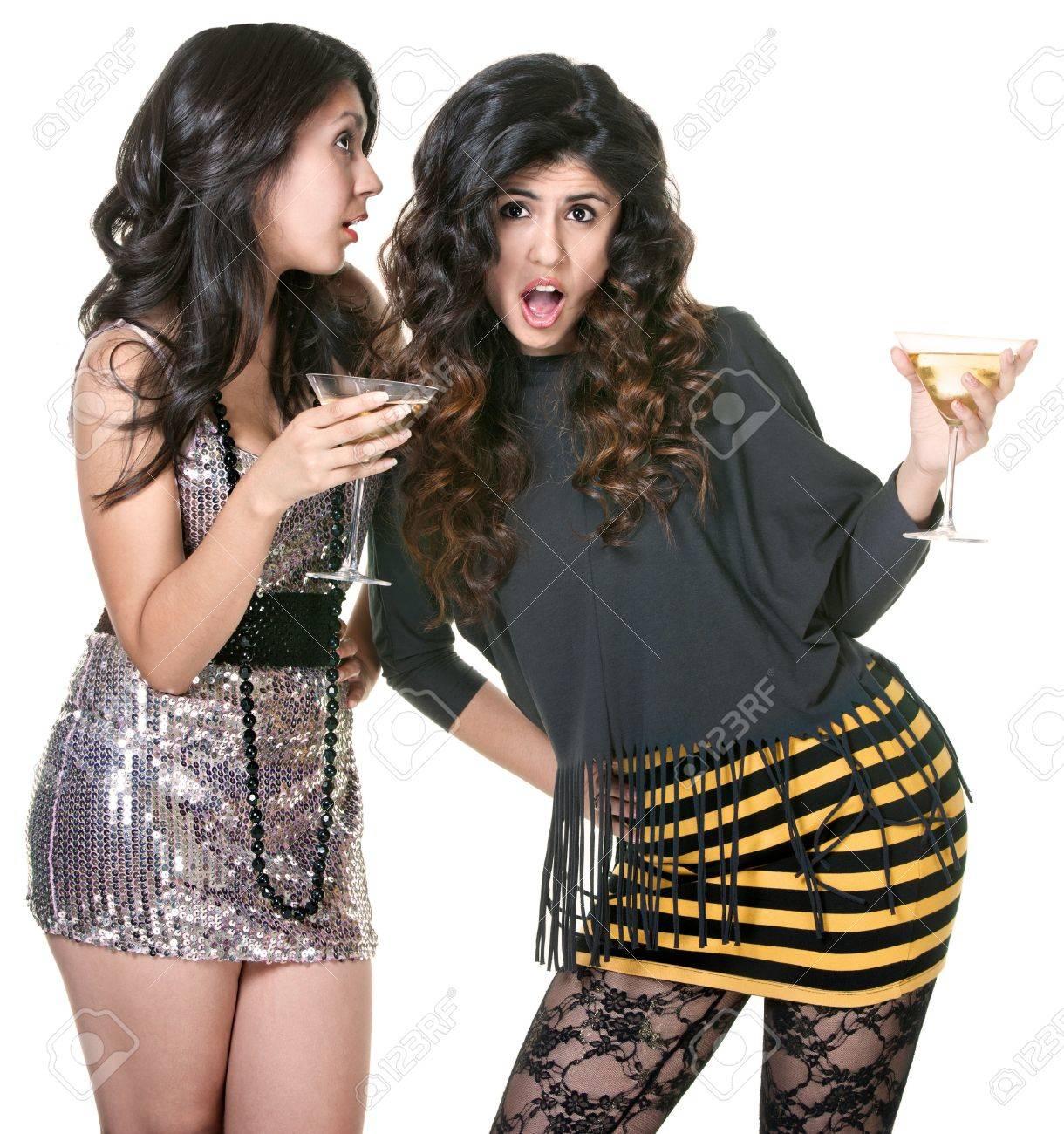 Surprised club girl listening to friend telling secrets Stock Photo - 18123501
