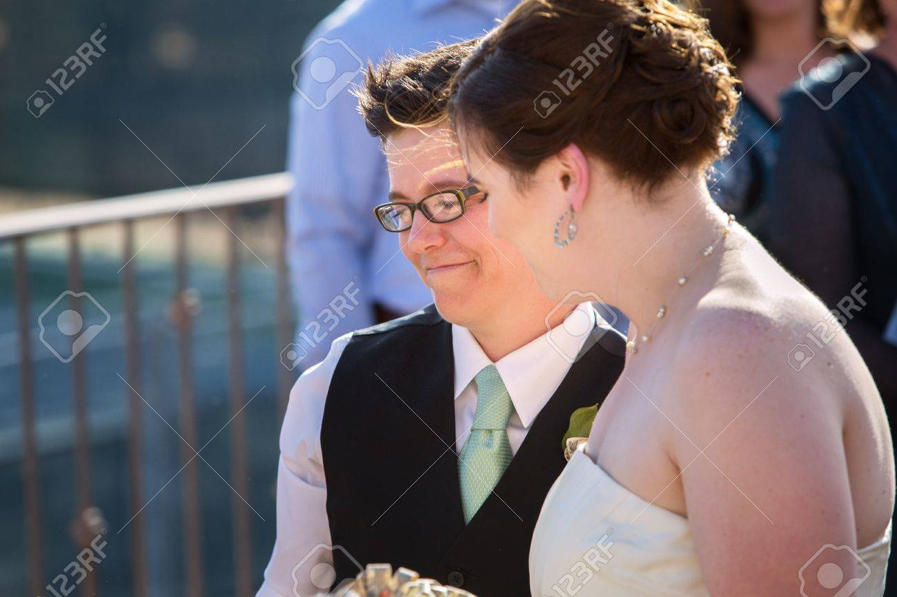 Happy young lesbian married couple standing outside Stock Photo - 18999184