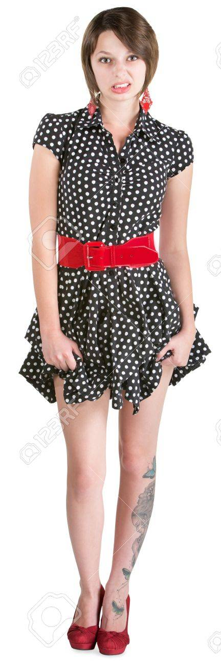 Disgusted young woman holding her polka dot dress Stock Photo - 18999123