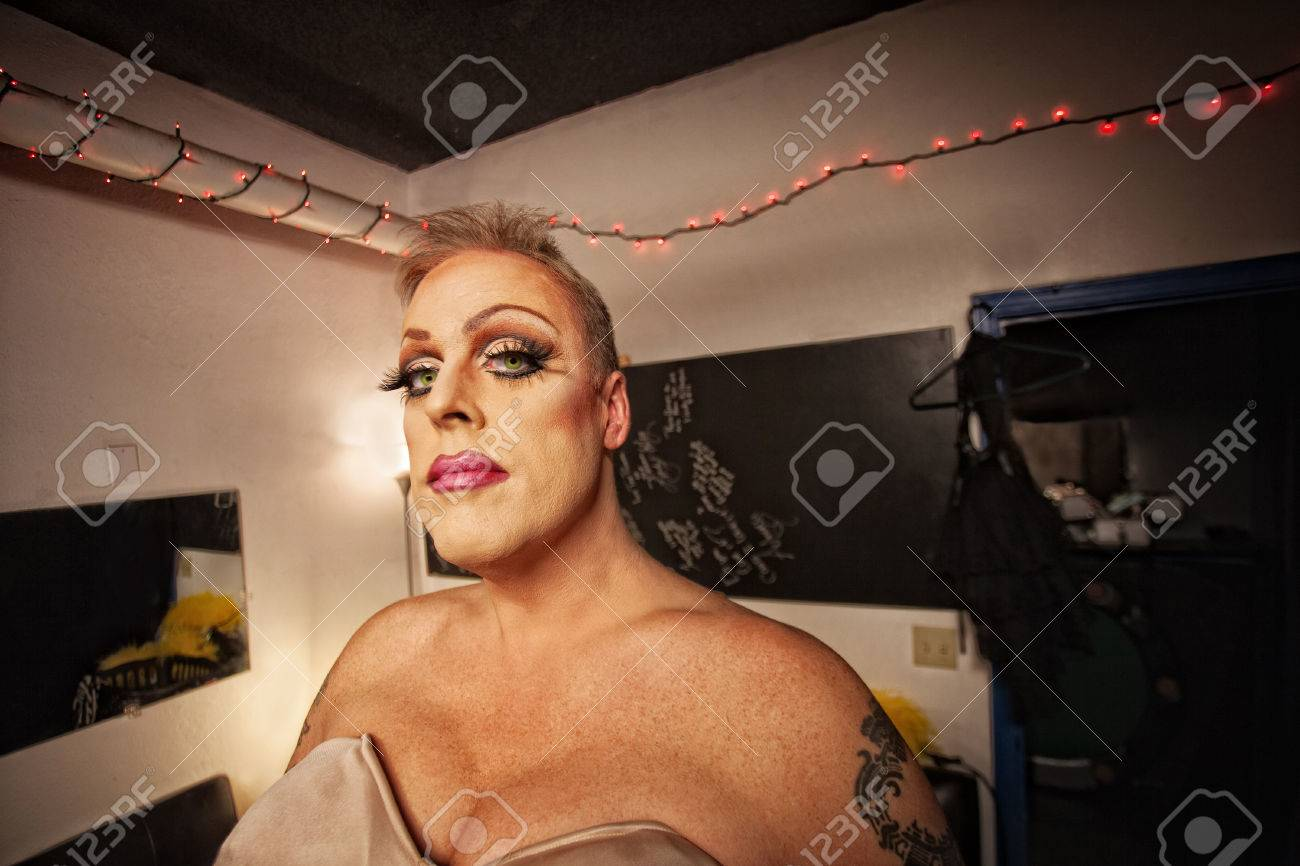 Serious Drag Queen With Bra And Tattoo In Dressing Room Stock Photo