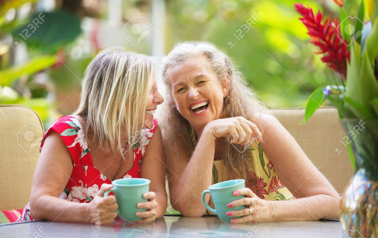 Pair of cute middle aged female friends laughing - 42781245