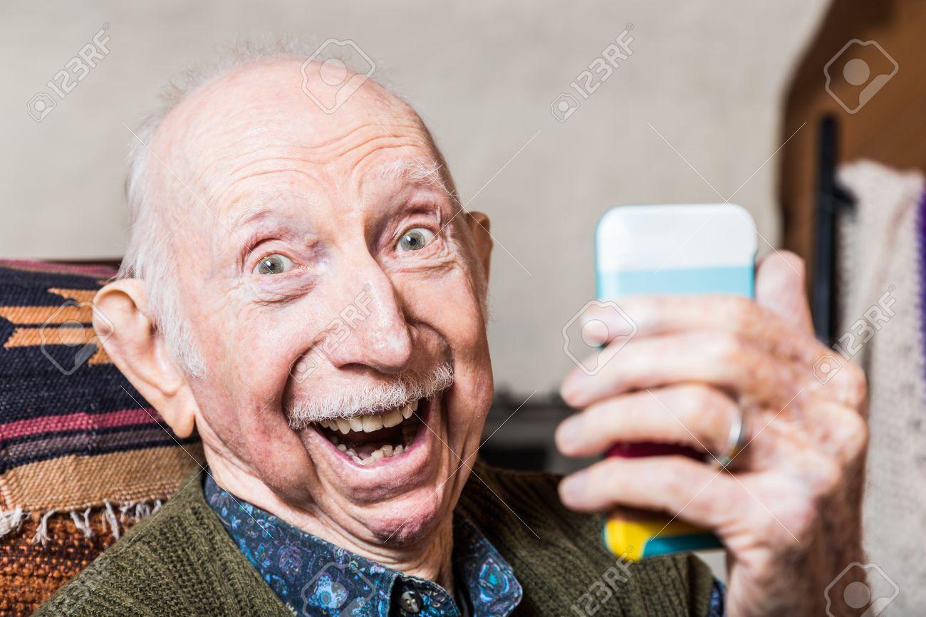Older gentleman taking a selfie with smartphone Stock Photo - 43582582