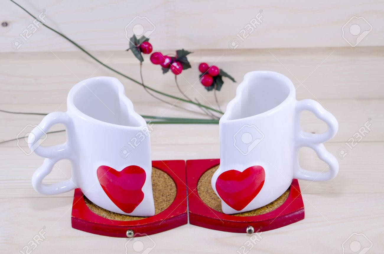 Unique Shaped Coffee Mugs unique heart shaped coffee mug split apart on a wooden table stock