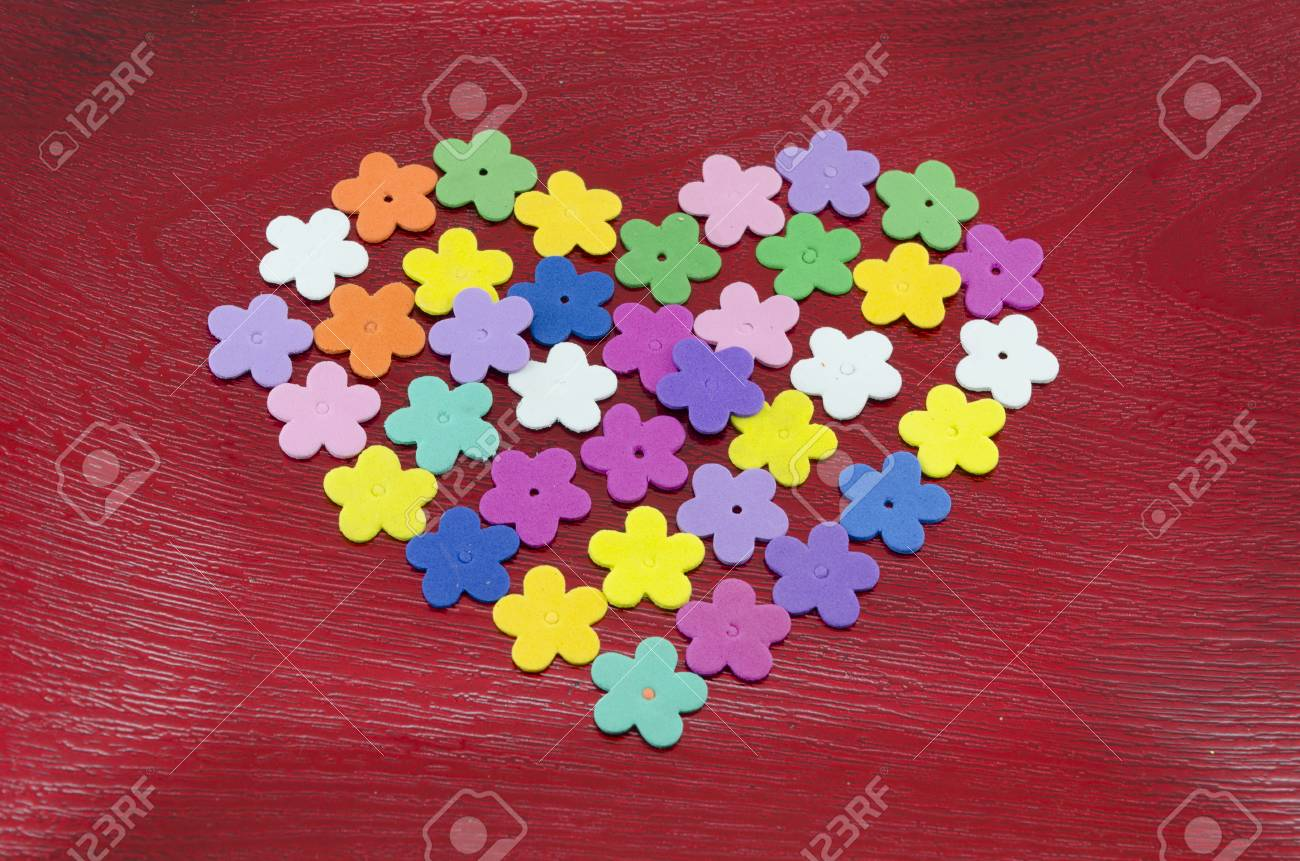 Heart Made Out Of Colorful Paper Flowers On Red Background Stock