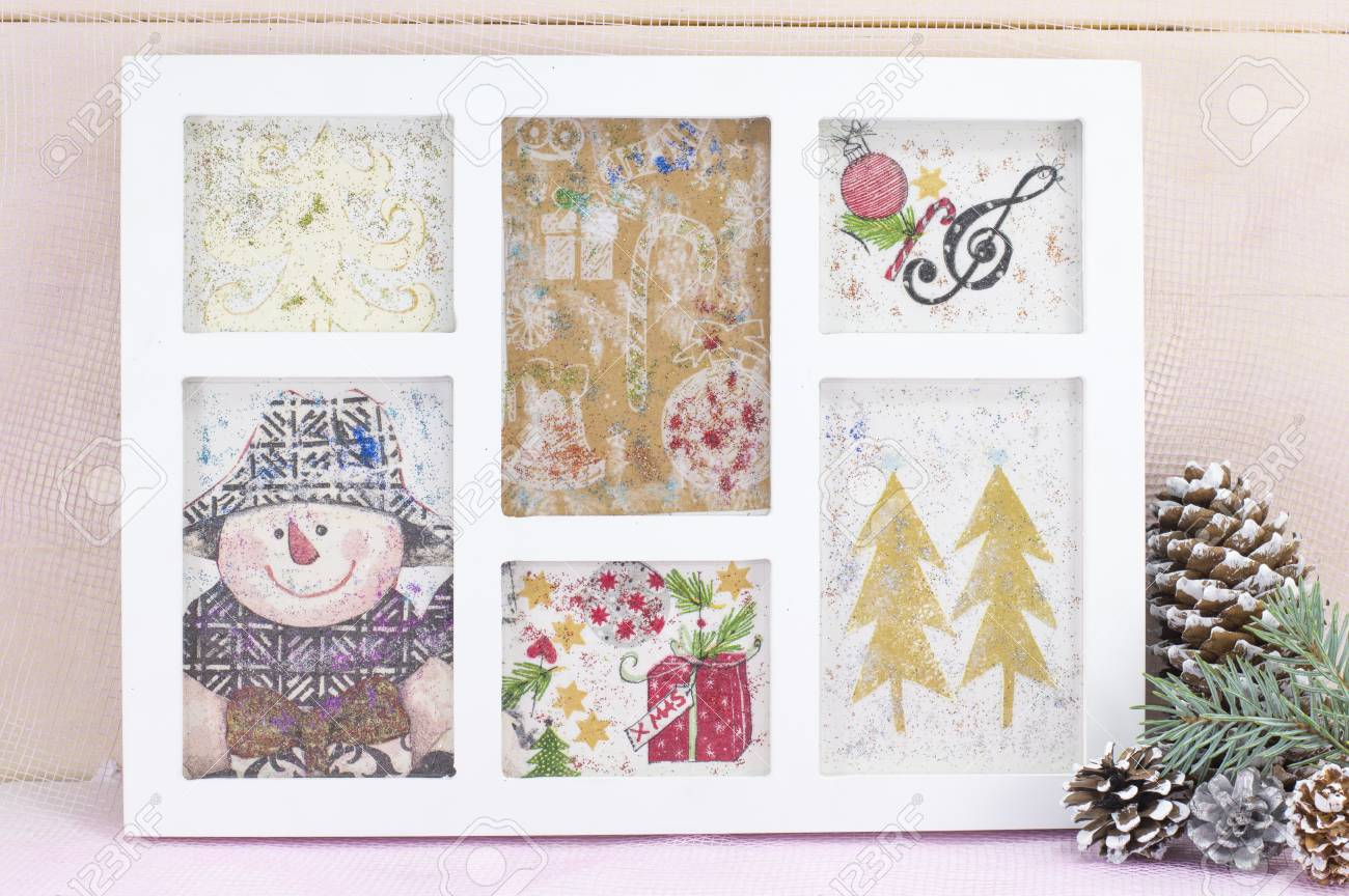Homemade decoupage Christmas decorations in a photo frame. Celebrating..