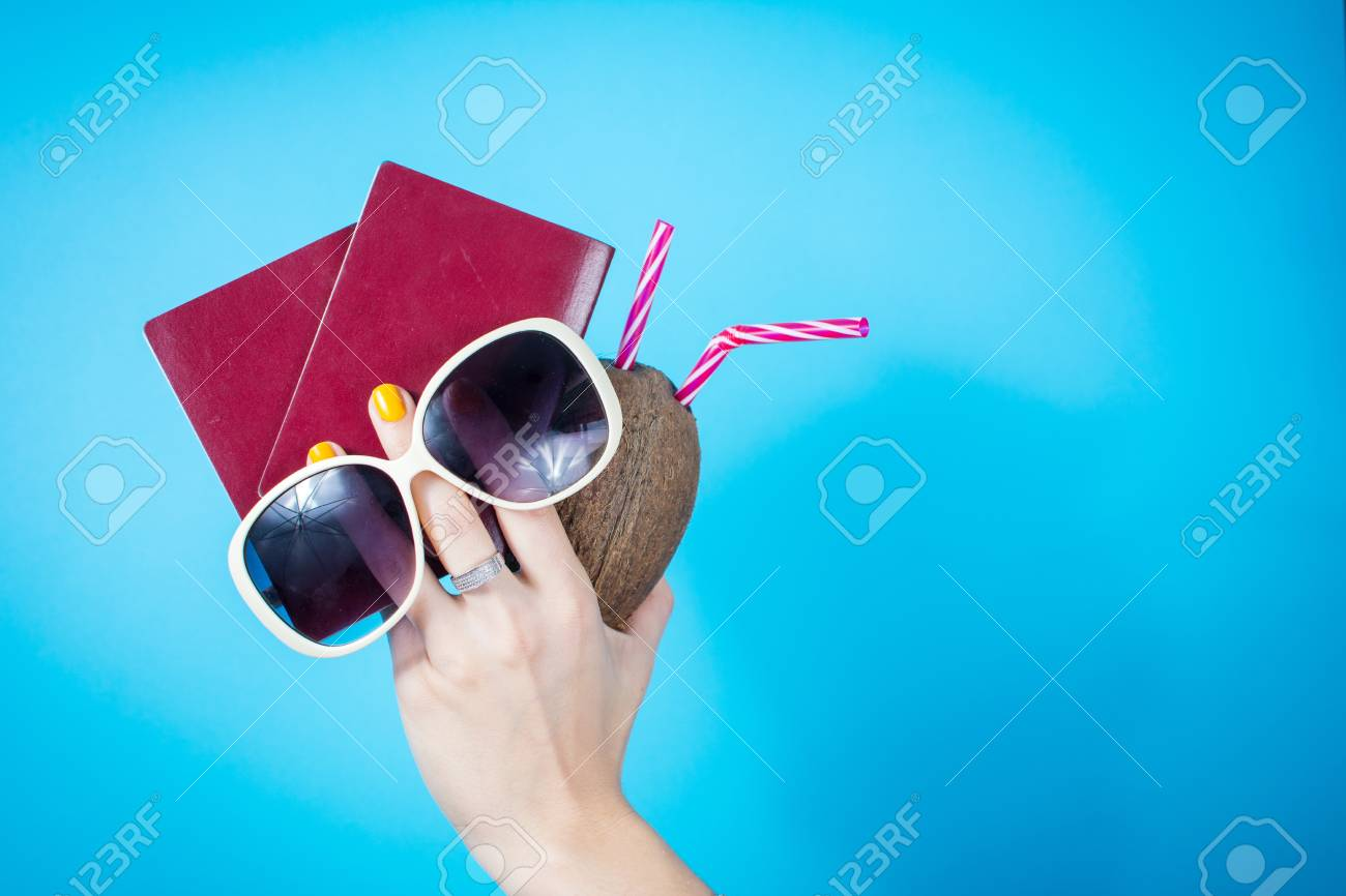 Womans Hand Holding A Two Passports And Summer Accessories Against ...