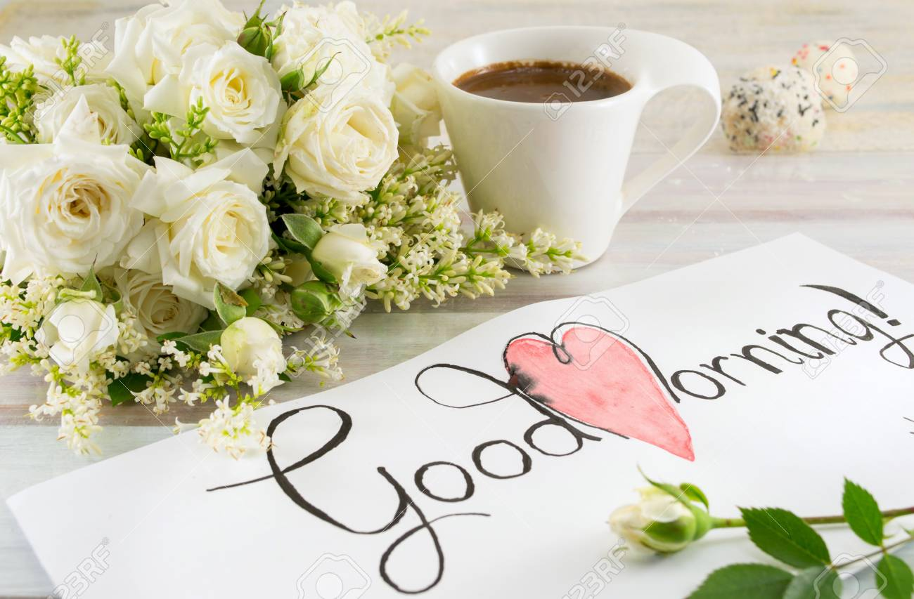 White Roses Coffee And Good Morning Note On A Table Stock Photo