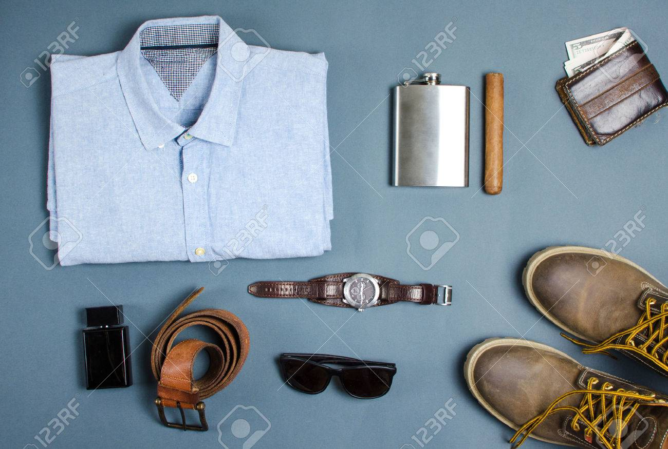 092860b0dd355 Male clothes and fashion accessories on blue background flatlay Stock Photo  - 74041895