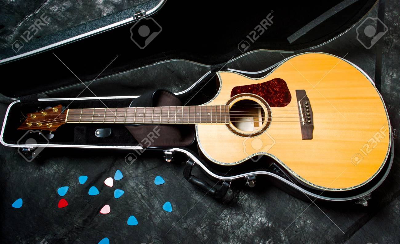 Acoustic Guitar In A Case On Dark Background Top Stock Photo