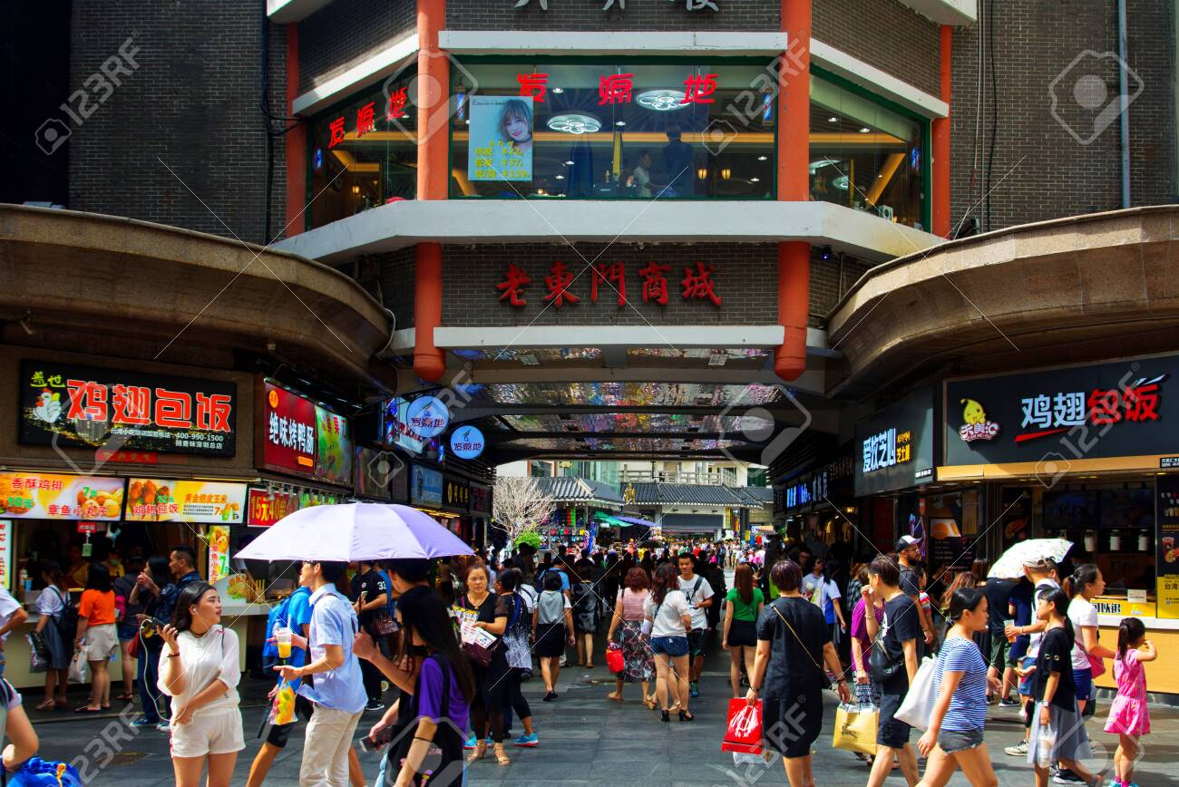 Shenzhen, China - July 16, 2018: Dong Men Pedestrian street in the old Shenzhen city area crowded with people on a sunny day - 137009150