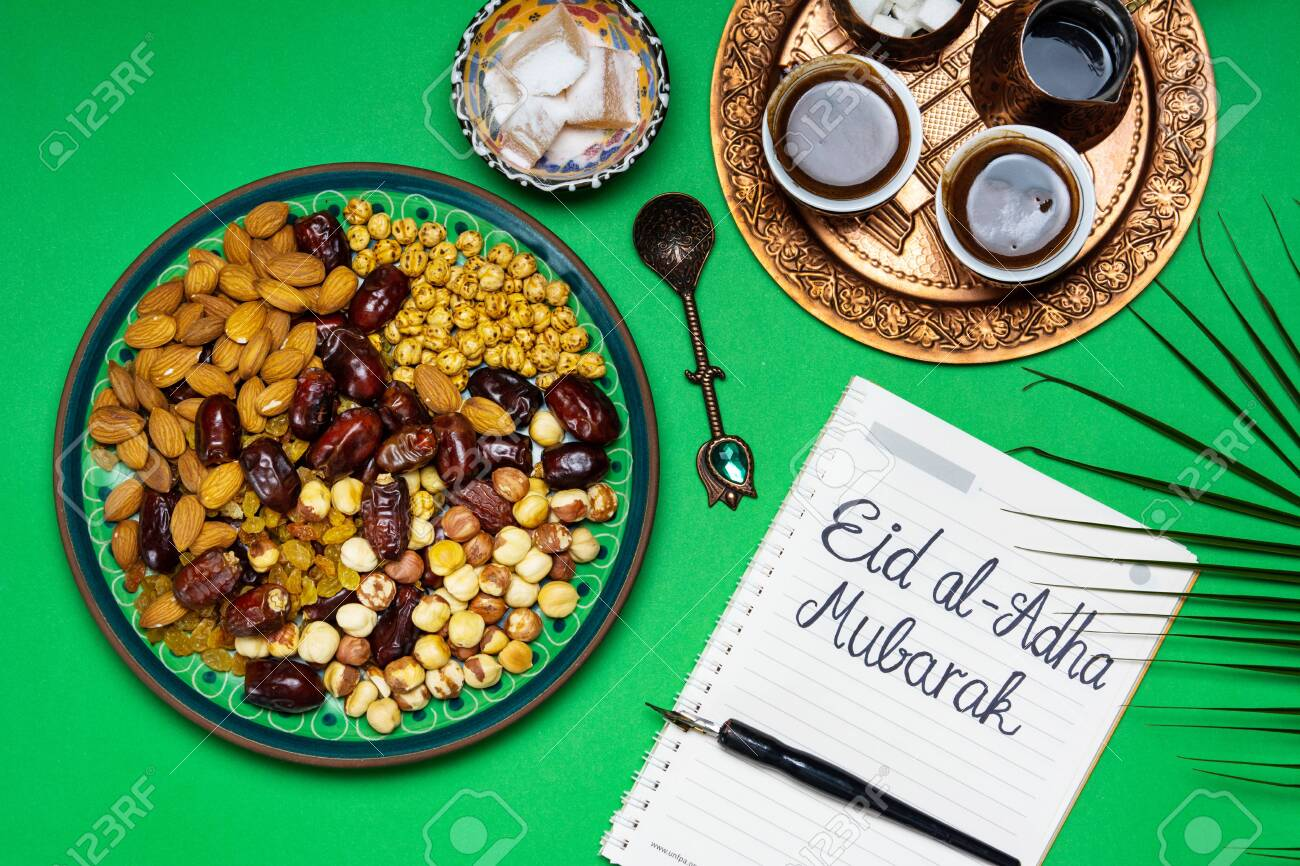 Eid Mubarak Note With Snacks And Coffee On A Table Stock Photo Picture And Royalty Free Image Image 123825886