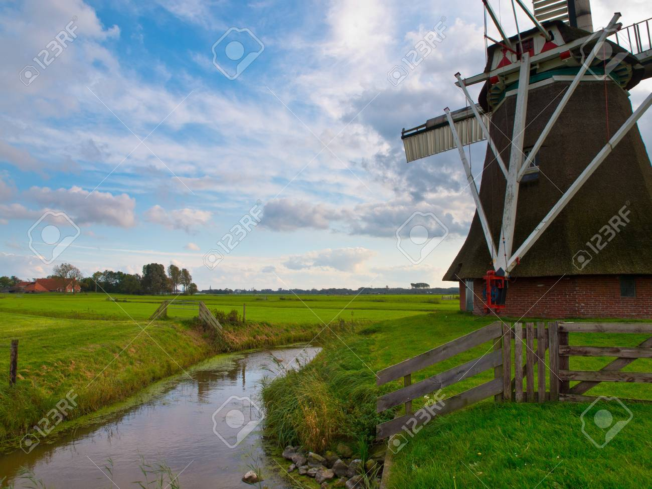Typical dutch agricultural landscape with old vintage windmill Stock Photo - 11334372