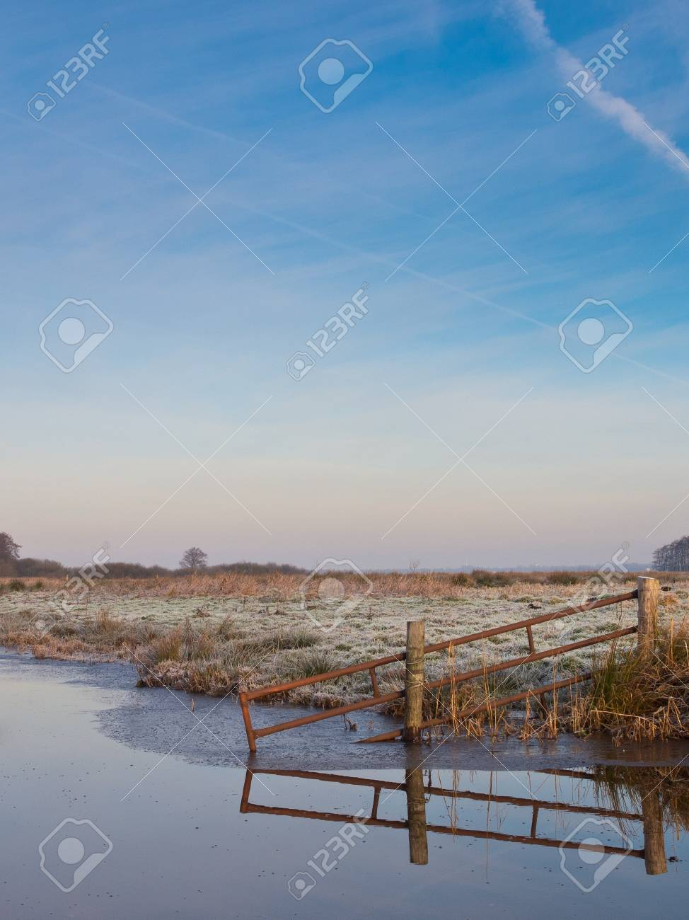 Gate used as fence in scenic rural winter landscape Stock Photo - 12285861
