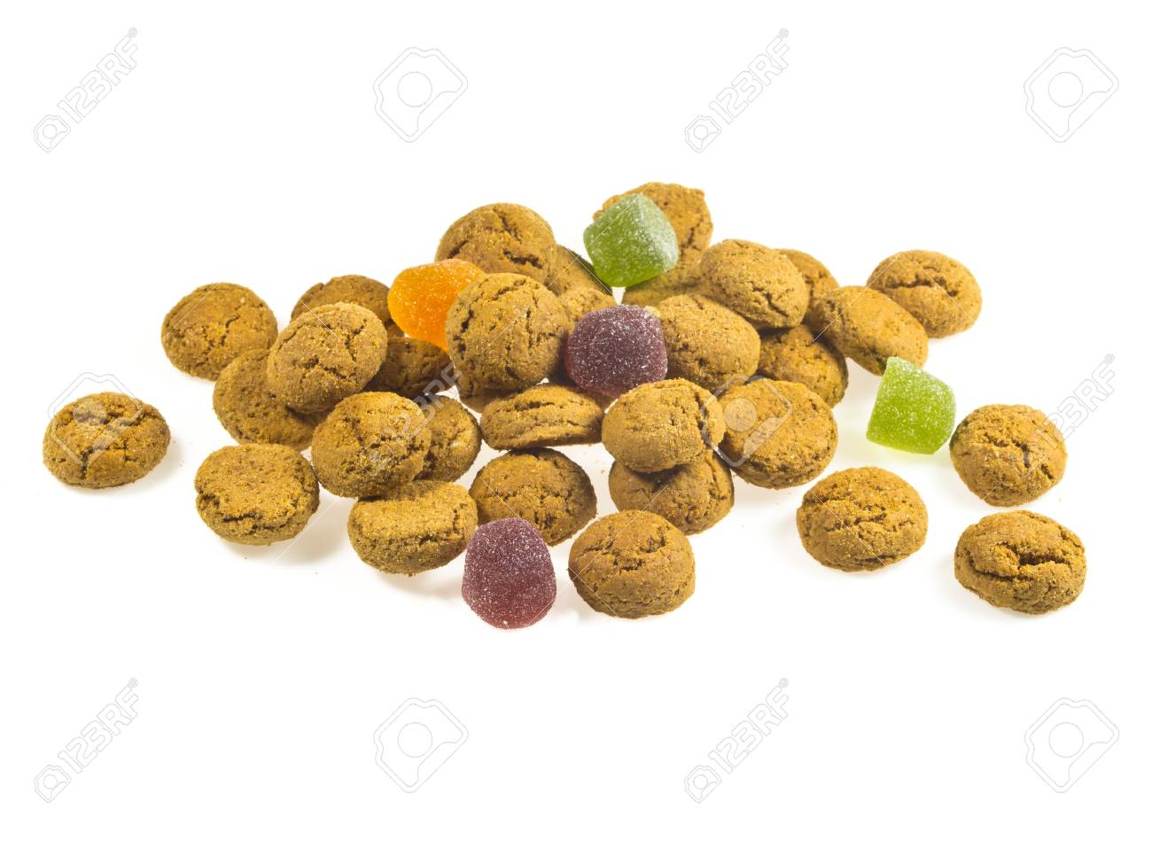 Pile of Pepernoten, typical Dutch treat for Sinterklaas in december, over White Background Stock Photo - 16627208