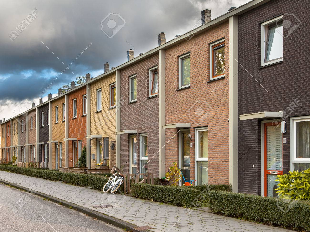 Modern Terra Colored Middle Class Terraced Houses in Europe Stock Photo -  24103117