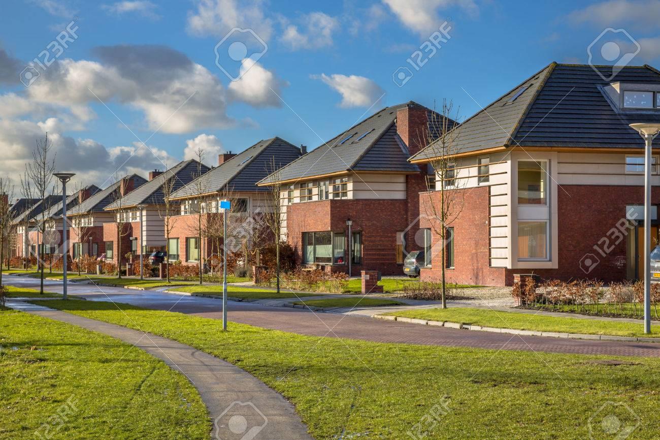 Detached dutch family houses along a suburban street in winter, Groningen, Netherlands - 50767417