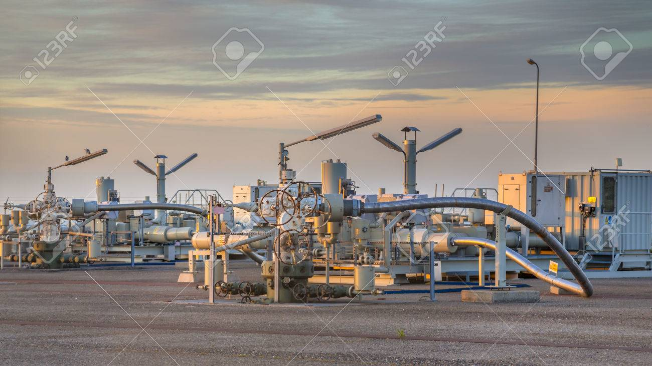 Natural gas production plant in the Waddensea area with pipe line valves - 51115505