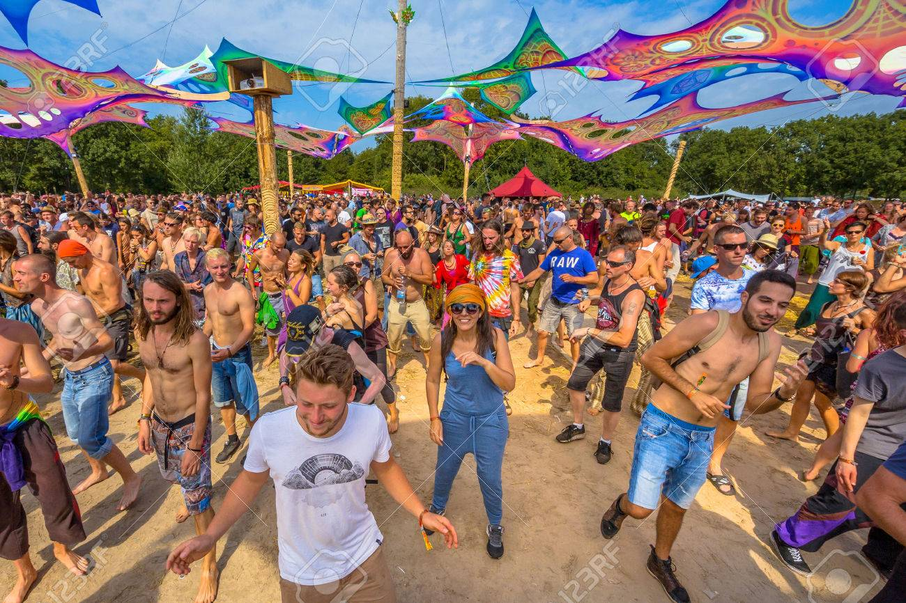 LEEUWARDEN, NETHERLANDS-AUGUST 30, 2015: Laughing happy party people having fun on the dance floor at Psy-Fi open air psychedelic trance music Festival - 52112969