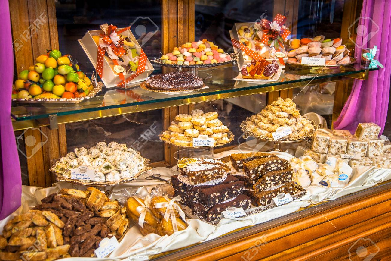 Traditional Italian Pastry shop glass display with selection of nougat, cookies, cake and sweets - 66232753