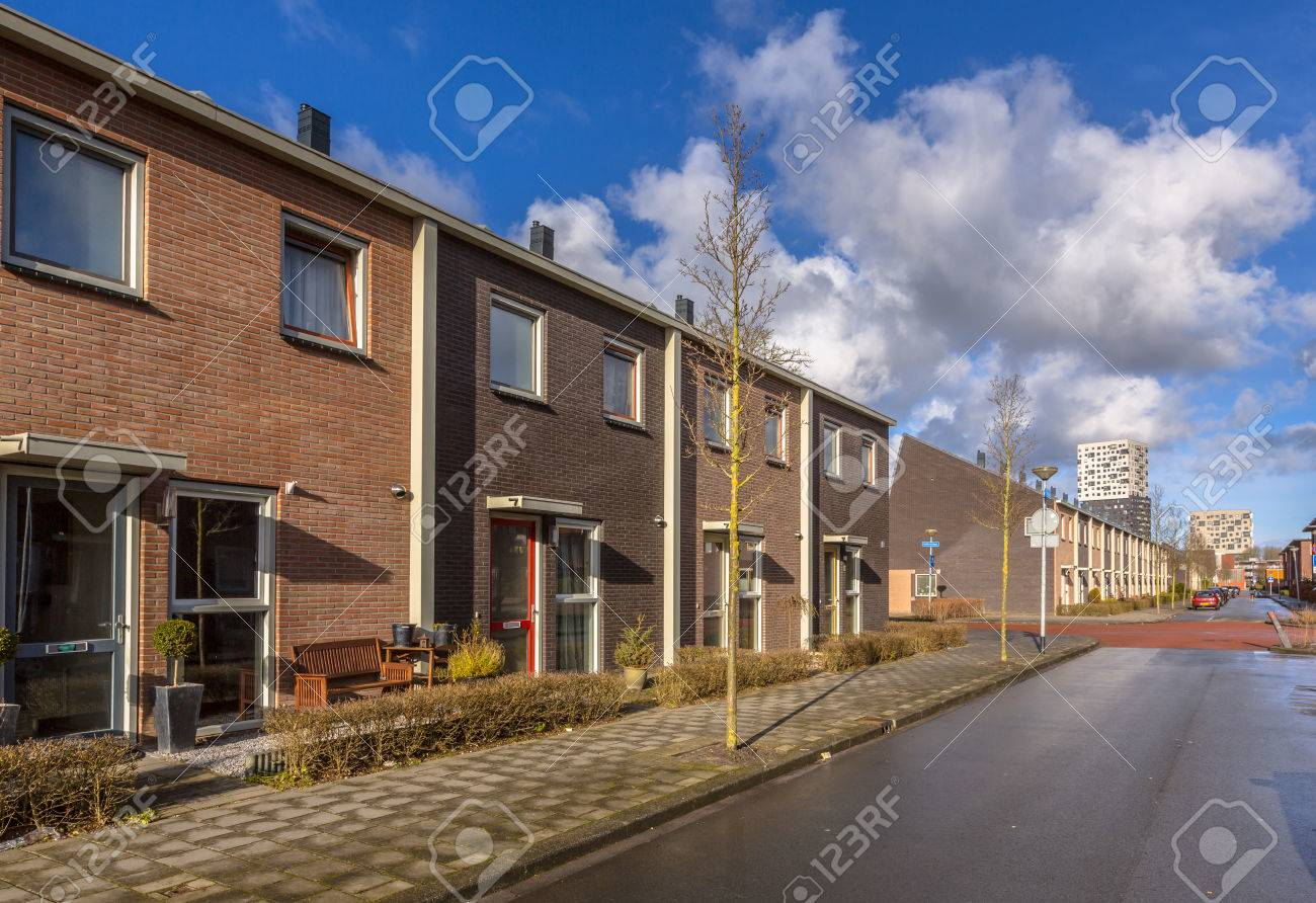 Modern Middle Class Town Houses in a street in the Netherlands, Europe - 65945768