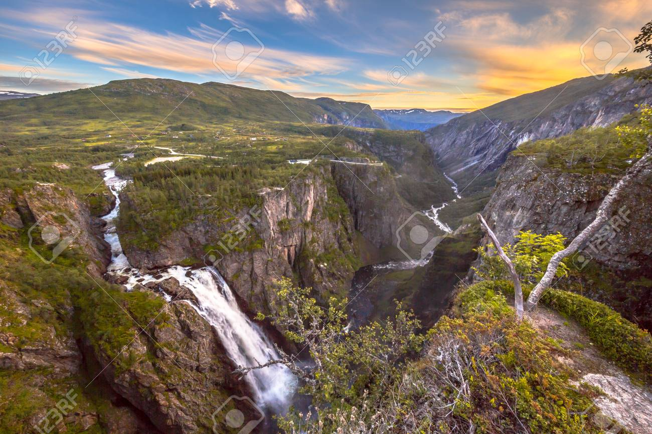 Famous Voringfossen gorge with waterfall near Eidfjord in province of Hordaland Norway - 83766476