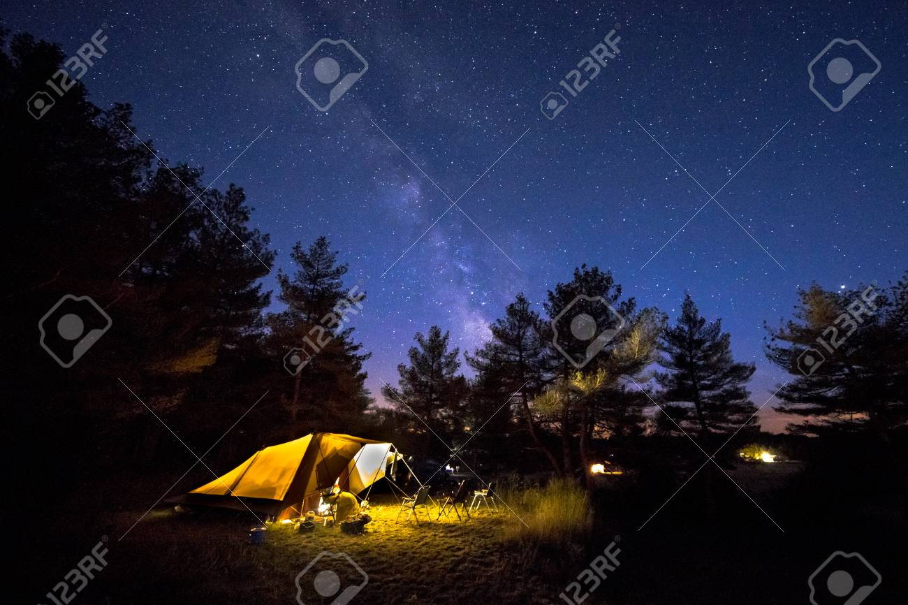 Family tent with rigid steel poles on camping ground under Starry sky with Milky Way - 115935649