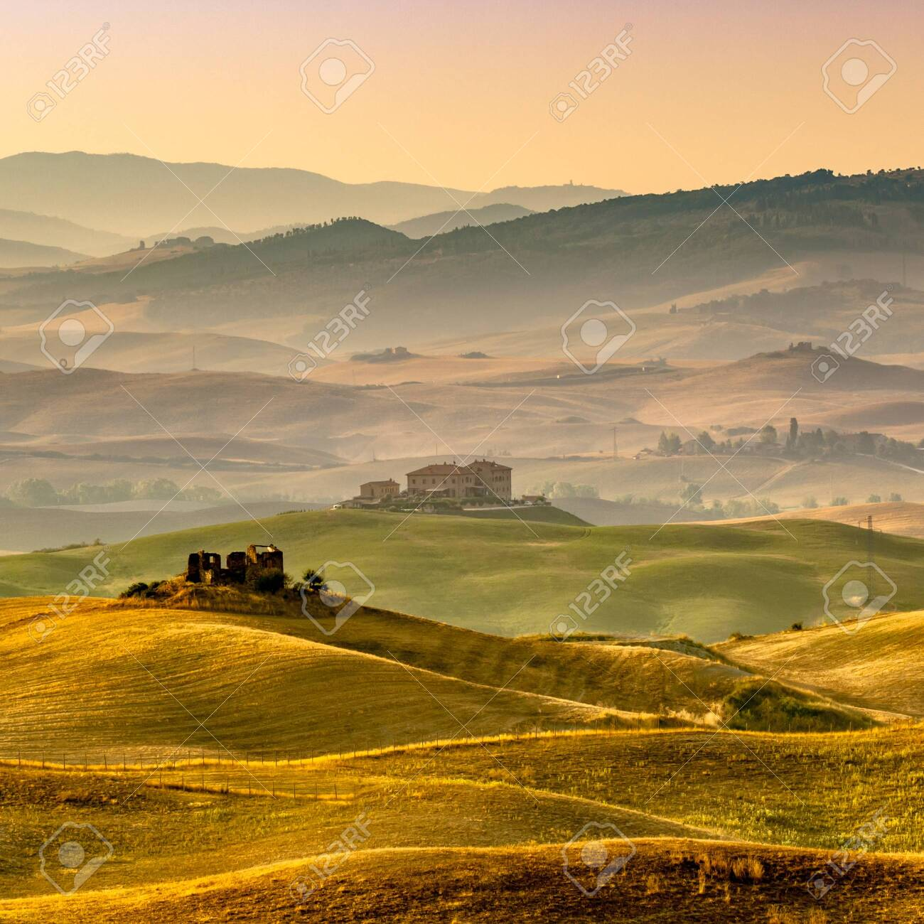 Sunrise over Farms in Hilly Countryside in Tuscany, Italy