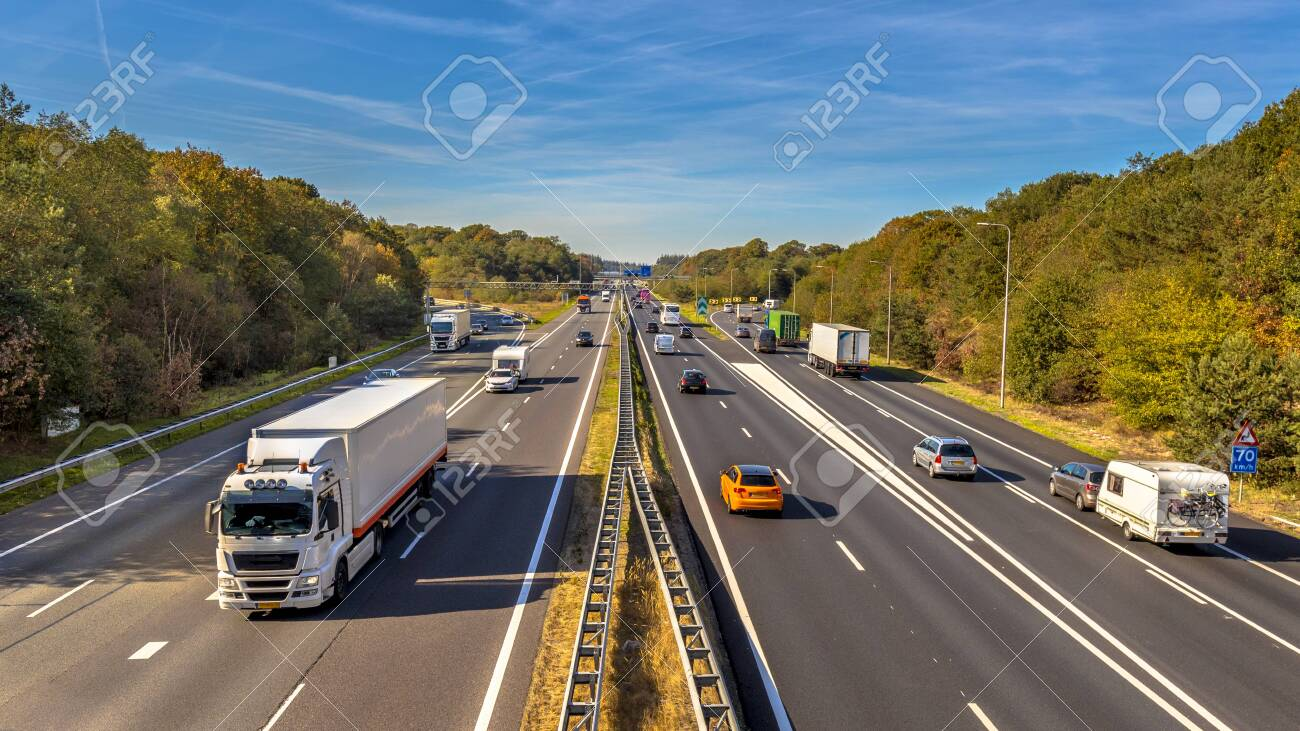 Afternoon motor Traffic on the A12 Motorway seen from above. This is one of the Bussiest highways in the Netherlands - 126500324