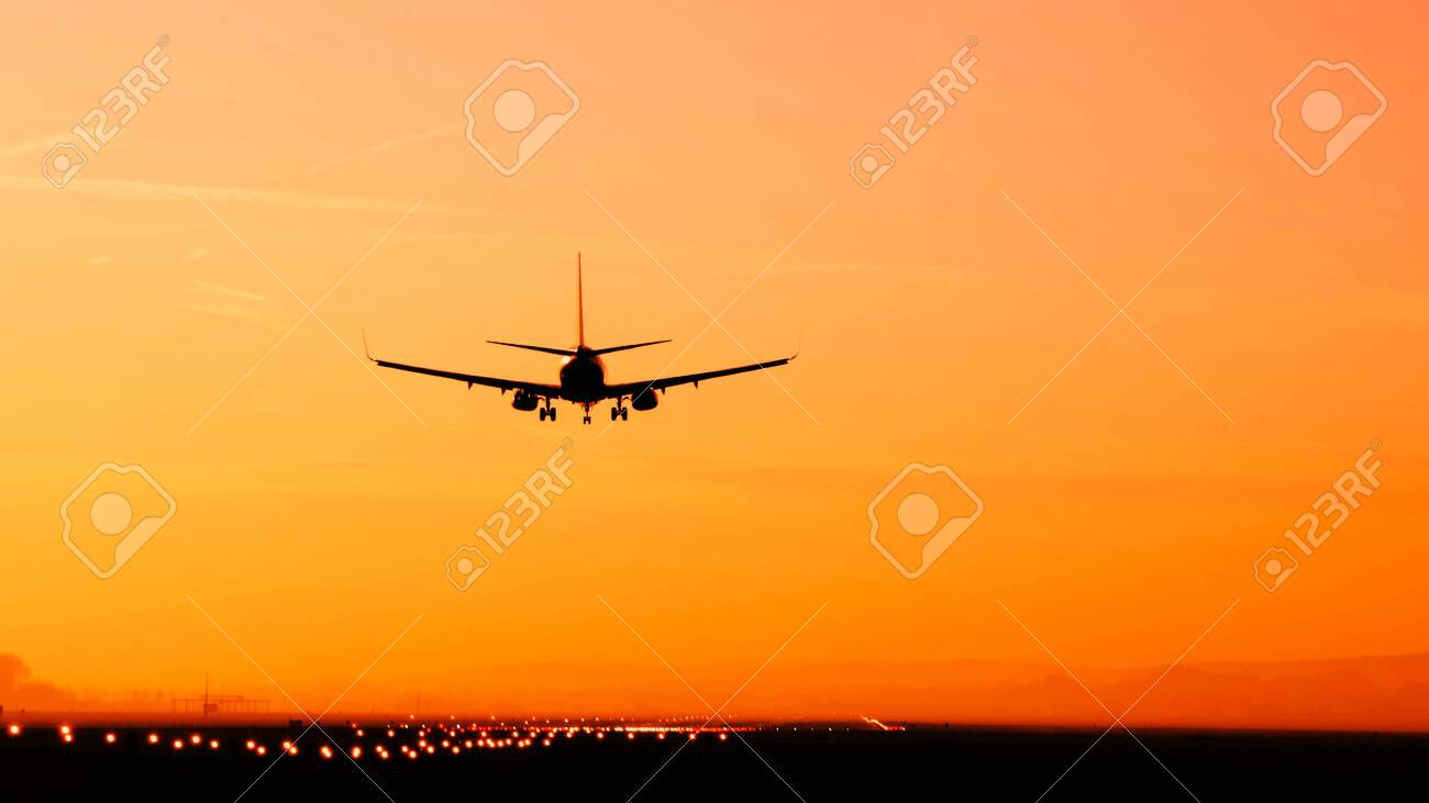 Back View Silhouette Of Airplane Landing At The Airport At Sunny Stock Photo Picture And Royalty Free Image Image 139036944