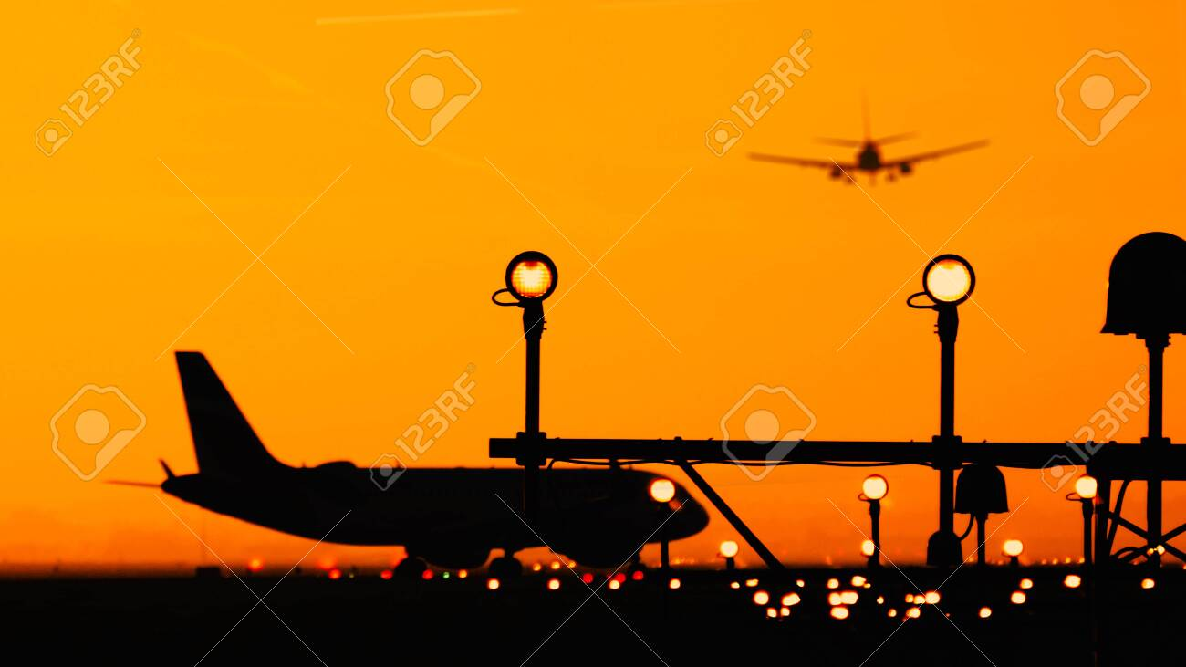 Silhouette Of Airplanes At The Airport At Sunny Orange And Purple Stock Photo Picture And Royalty Free Image Image 139037165