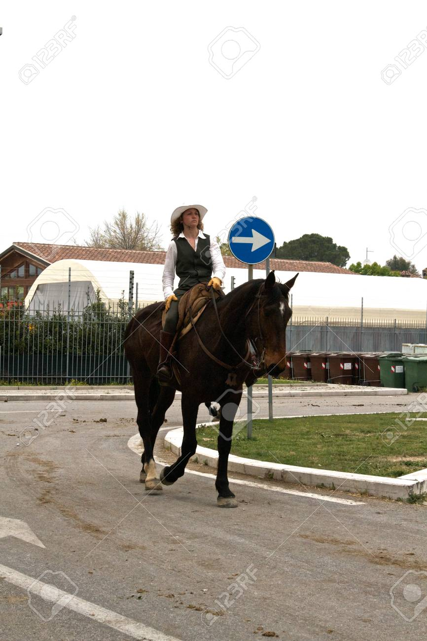 Woman riding gently on her horse on a public road at Roma Cavalli horse fair in Rome, Italy on April 2011. Stock Photo - 9386510