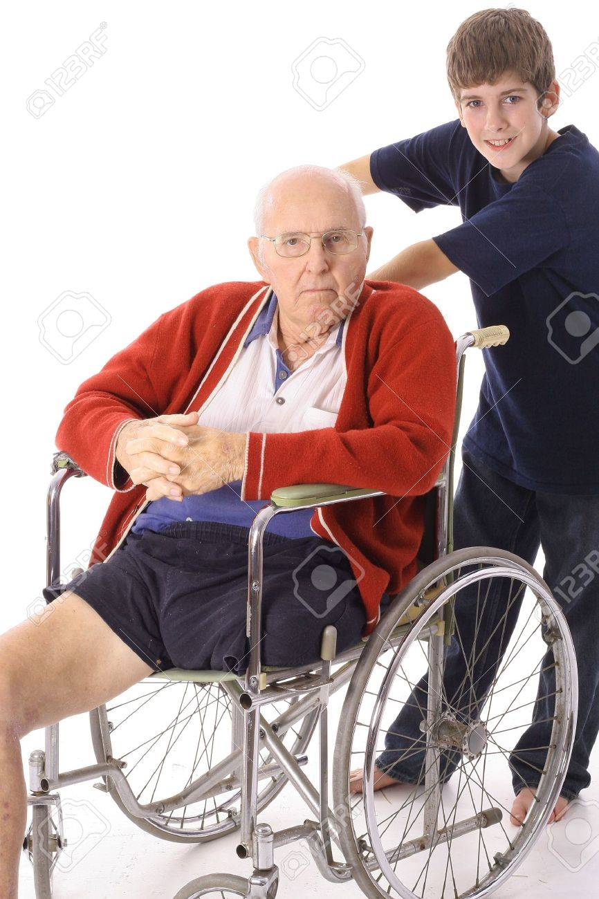 young boy pushing great grandfather in wheelchair Stock Photo - 3506038