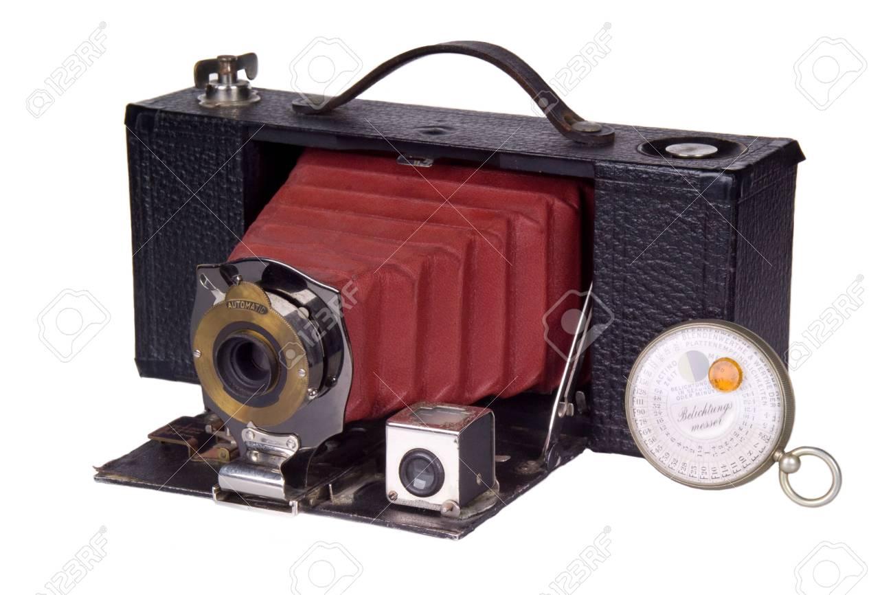 Antique classic film camera and light meter