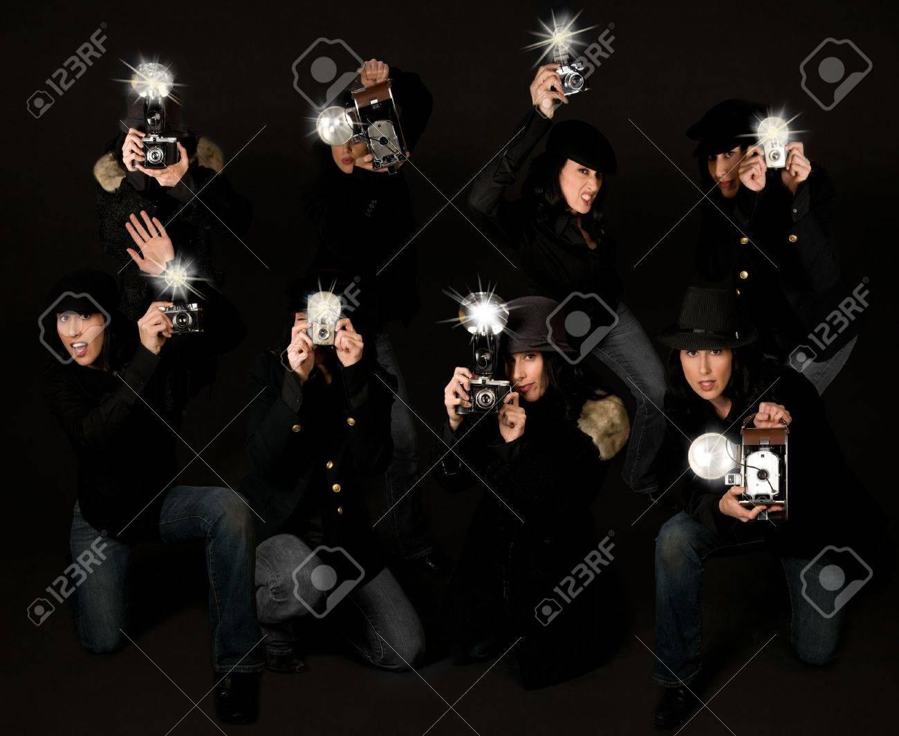 Retro style female paparazzi press photographers with vintage cameras Stock Photo - 3937504